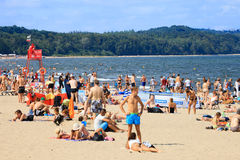 Crowded sandy beach in Sopot Stock Images