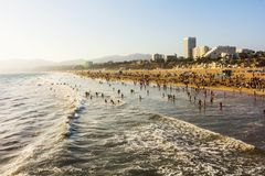 Crowded Santa Monica beach at sunset Stock Images