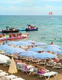 Crowded sea beach Stock Photos