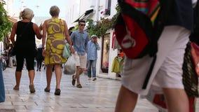 Crowded shopping street near the Aegean sea promenade. stock footage