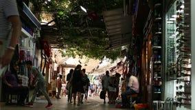 Crowded shopping street near the Aegean sea promenade. stock video footage