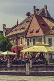 Crowded sidewalk cafe, Sibiu, Romania Royalty Free Stock Image