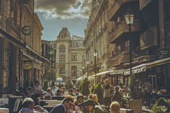 Crowded sidewalk cafes Royalty Free Stock Photos