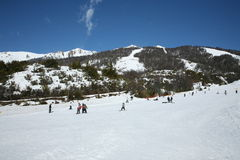 Crowded ski resort. A scene of a ski resort in Cathedral Hill, Bariloche, Argentina. Skiers can be seen on the gentle slopes while higher slopes covered with Stock Images