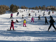 Crowded ski slope on a perfect sunny day. Many skiers gather on this popular ski slope on a beautiful weekend. Photo taken in January 2013 at Heavenly California Royalty Free Stock Image
