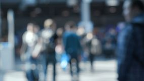 Blurred silhouettes of people going to airport. Crowded space with adult male persons near entrance to subway metro or financial corporate college for stock footage