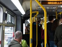 Crowded standing room only bus on 38 Geary line on MUNI crossing Arguello St stock image