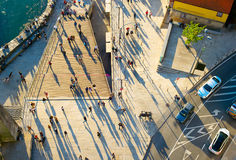 Crowded street, aerial view. Aerial view of a people walking on the street at sunset Stock Photography
