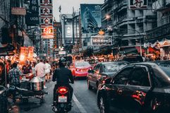 Crowded Street With Cars Passing By Stock Image