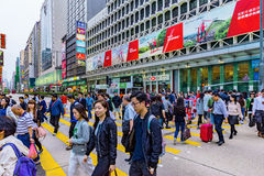 Crowded street crossing in Hong Kong. HONG KONG, CHINA - APRIL 24: This is a crowded street crossing in the busy Mong Kok area of Kowloon where you can see many Royalty Free Stock Photos