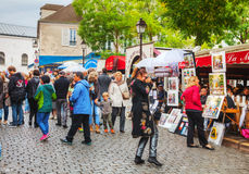 Crowded street on the Montmartre hill in Paris Stock Images