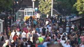 Crowded street with people and a tram car stock video