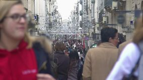 Crowded street, people walking near stores at beautiful city center, urban life. Stock footage stock footage