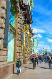 The crowded street. SAINT PETERSBURG, RUSSIA - APRIL 25, 2015: The walk along the crowded Nevsky Prospekt, at the stone wall of Singer House, widely known as the Royalty Free Stock Photo