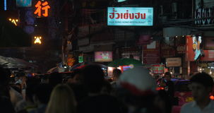 Crowded street and transport traffic in night Chinatown, Bangkok. BANGKOK, THAILAND - NOVEMBER 02, 2015: Night shot of Chinatown. Crowd of people walking in the stock footage