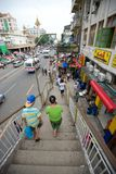 Crowded street in Yangon. View from an overhead bridge in Chinatown, Yangon, Myanmar Stock Image