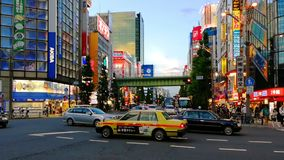 Crowded streets of Akihabara area in Tokyo, Japan during the hot evening stock footage