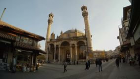 Crowded streets and Azizia mosque in the Sufi city of Konya. KONYA / TURKEY - 11.20.2016 central streets of the ancient Turkish city stock video