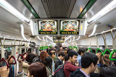Crowded Subway. Seoul, South Korea - October 24, 2014: A crowded train carriage at rush hour in the Seoul subway, Korea stock image
