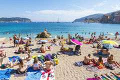 Crowded summer beach in Villefranche-sur-Mer, Nice, France Stock Photo