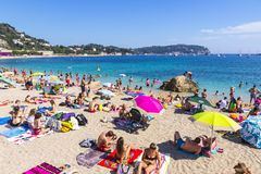 Crowded summer beach in Villefranche-sur-Mer, Nice, France Royalty Free Stock Images