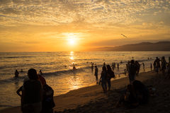 Crowded Sunset. A crowded beach watching the sunset over the ocean Stock Photo