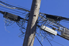 Crowded Telephone Poles with Tangled Lines Representing Old Technology Stock Photo