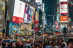 Crowded Times Square at Night and LED Advertising Lighting up th Stock Photos