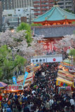Crowded Tokyo street during Cherry Blossom season Stock Photos