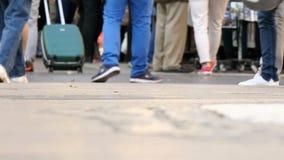 Crowded Tourists Feet in Las Ramblas Street. People crowd crossing a boulevard street stock video