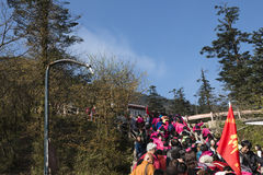 Crowded tourists on mountain Royalty Free Stock Image