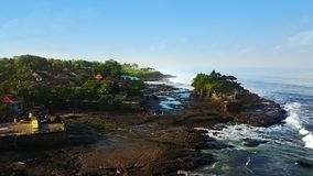 Crowded tourists visiting in the Tanah Lot temple. Aerial view of crowded tourists visiting in the Tanah Lot temple in Bali, Indonesia Stock Images