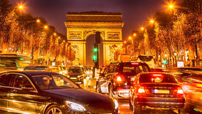 The Crowded Traffic in Paris. Night image of the crowded traffic in Paris on Champs Elysees during the winter holidays Royalty Free Stock Images