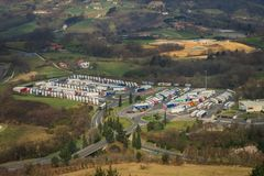 The crowded truck parking in Spain stock photography