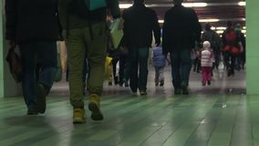 Crowded underground passage, people walking at subway station, slow-motion. Stock footage stock video