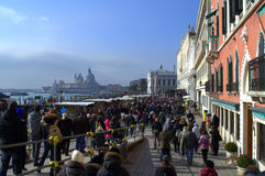 Crowded Venice embankment Stock Photo