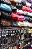 Crowded Wall Covered with Bags and Shoes. A crowded wall of a stall, displaying merchanises consisting of bags and shoes Royalty Free Stock Photography