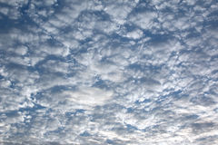 Crowded white clouds Stock Image