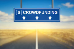 Crowdfunding words on blue road sign Stock Photography