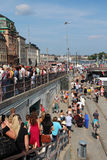 Crowding people watching the Pride Parade at Slussen in central Stockholm. Royalty Free Stock Photos