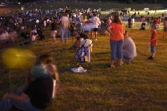 Crowds. People outside at night in Texas Royalty Free Stock Photography
