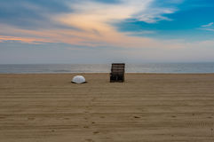 Before the Crowds Arrive. Lifeguard station and life boat on the beach before the crowds arrive Stock Photos