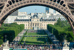 Crowds Beneath the Eiffel Tower Arches II Stock Image