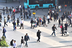 Crowds at bus station Stock Images