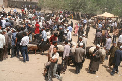 Crowds on busy uighur market Stock Photos