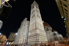 Crowds at Campanille of Santa Maria del Fiore cathedral at night Stock Photo