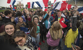 Crowds celebrate Macron`s victory at the Louvre Museum Stock Images