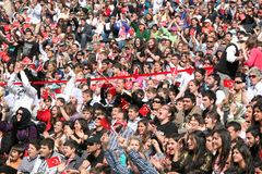 Crowds cheering. ISTANBUL - APRIL 23: Children cheer with Turkish flags during National Sovereignty and Children Day festival on April 23, 2010 in Istanbul Stock Photos