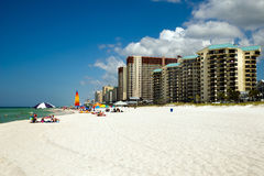 Crowds dot the beach in Panama City Beach, FL Royalty Free Stock Images