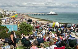 Crowds at the Eastbourne Airshow, England. Crowds of people along the seafront at Eastbourne in East Sussex, England for the airshow stock photos